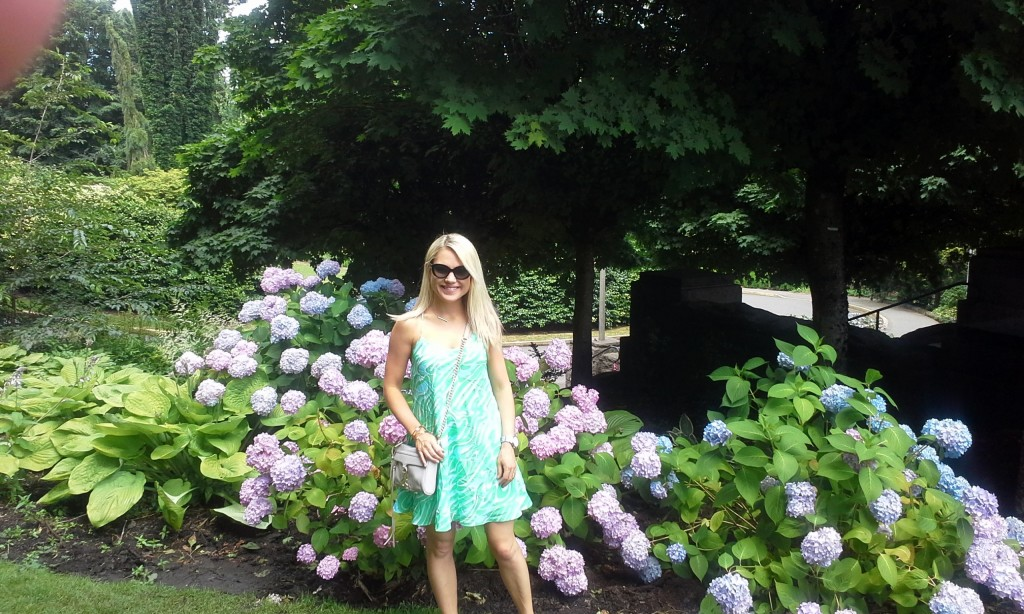 girl in green lilly pulitzer dress next to hydrangeas