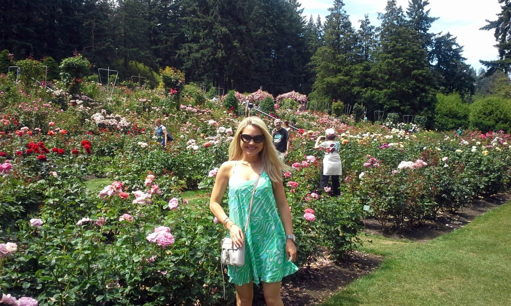 girl in Lilly Pulitzer dress standing in rose garden