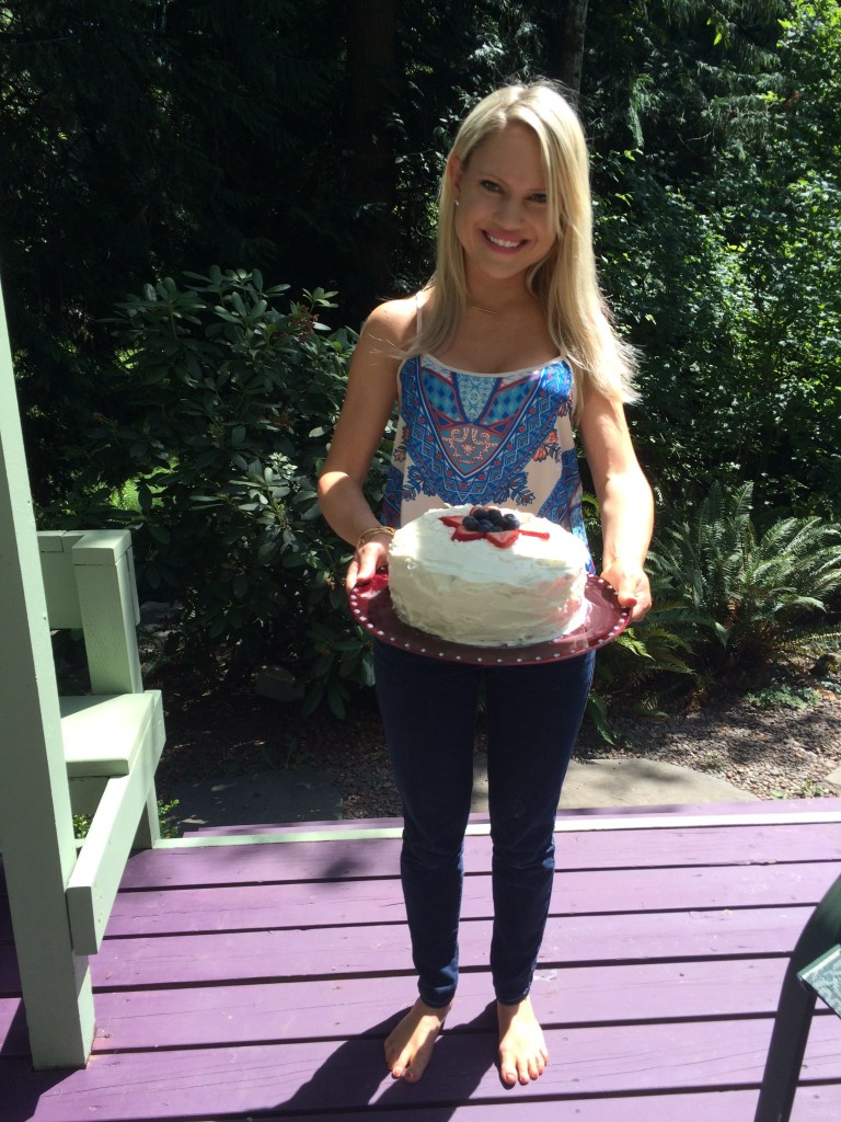 girl holding 4th of july cake
