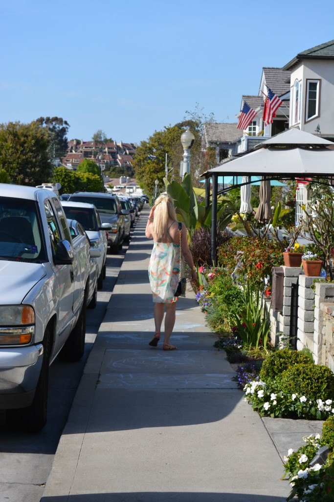 girl walking down the gem streets on Balboa Island