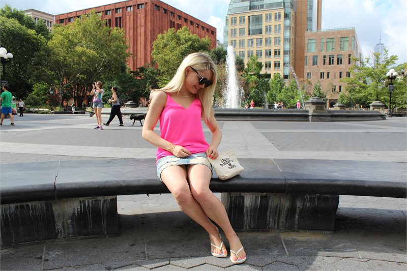 girl on a park beach in hot pink topshop tank top, karen walker sunglasses and denim skirt Caitlin Hartley of Styled American http://styledamerican.com/first-week-in-new-york/
