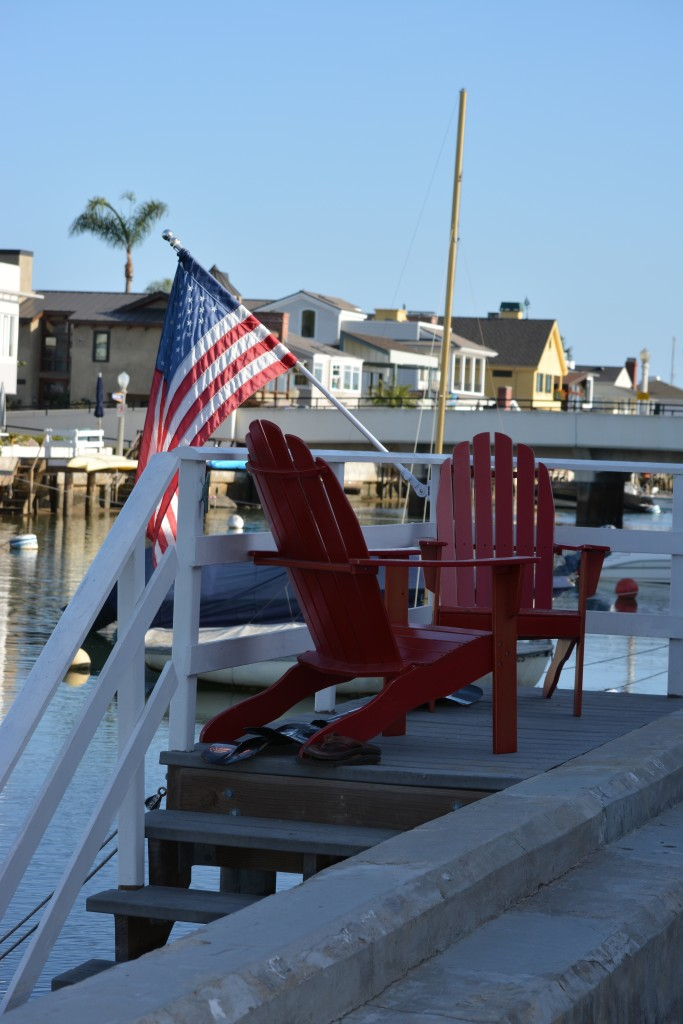 red chairs and american flag on home boat dock