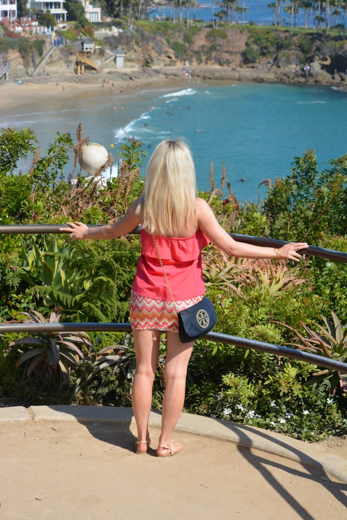 girl looking out at Laguna Beach