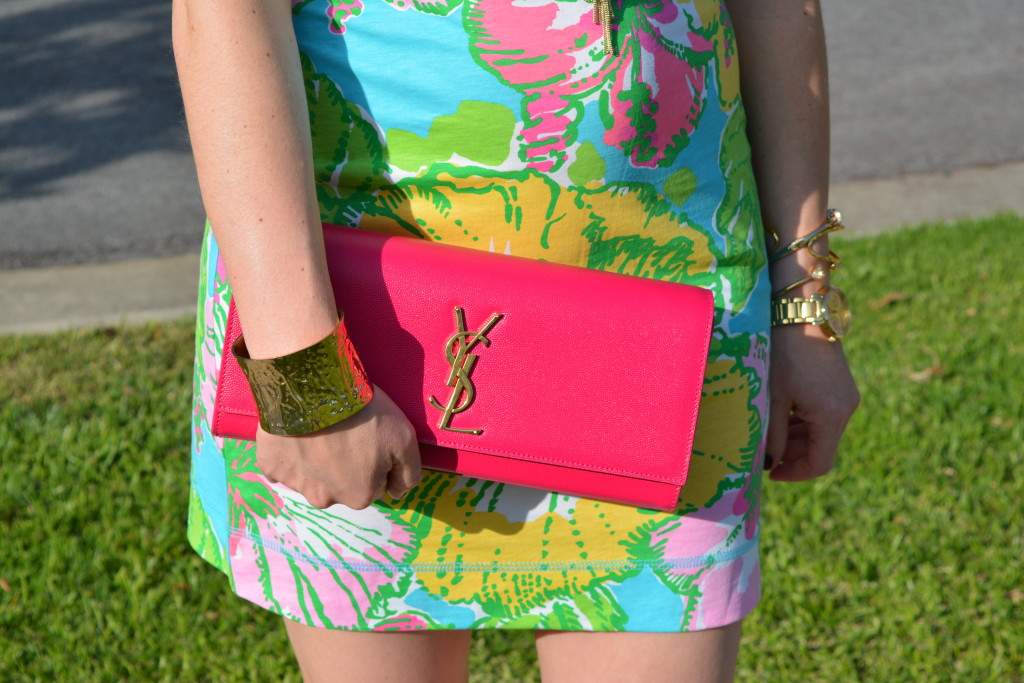 Hot pink YSL bag, Lilly Pulitzer floral dress and gold jewelry Caitlin Hartley of Styled American