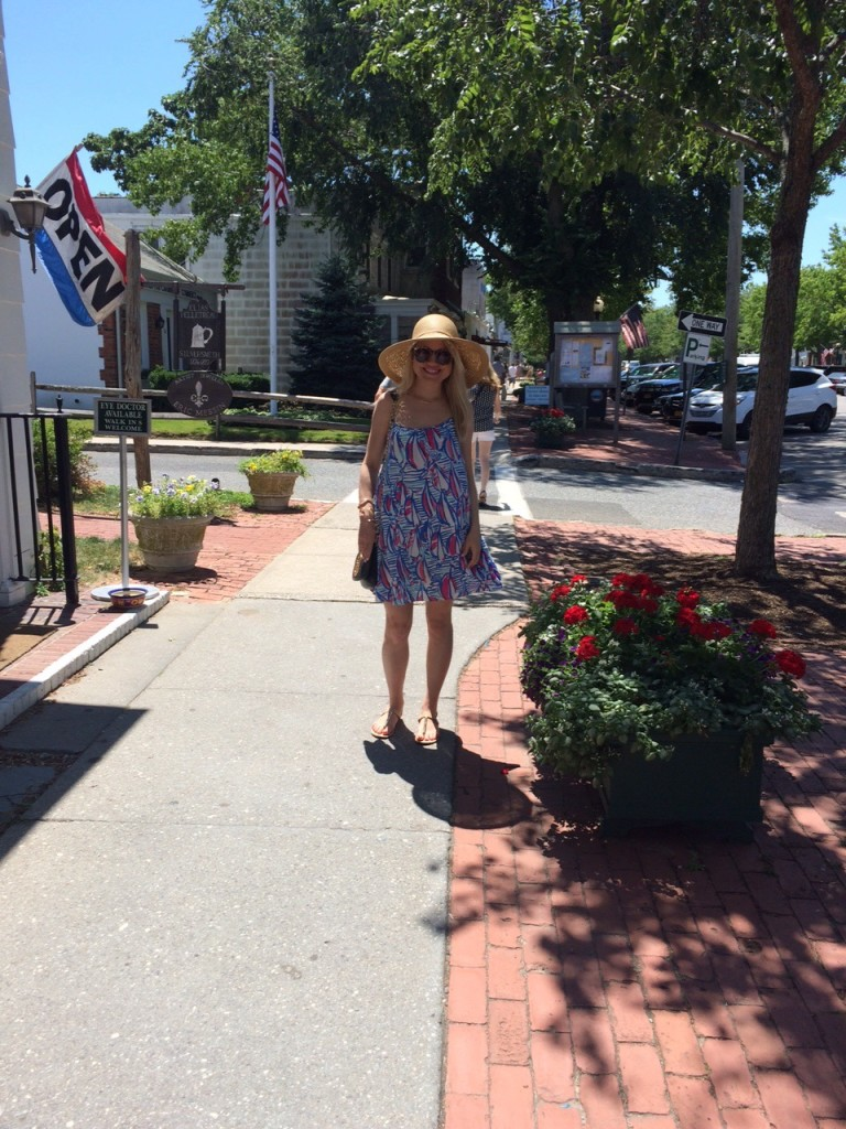 girl in Sailboat Lilly Pulitzer dress on Main Street in Southampton Caitlin Hartley of Styled American