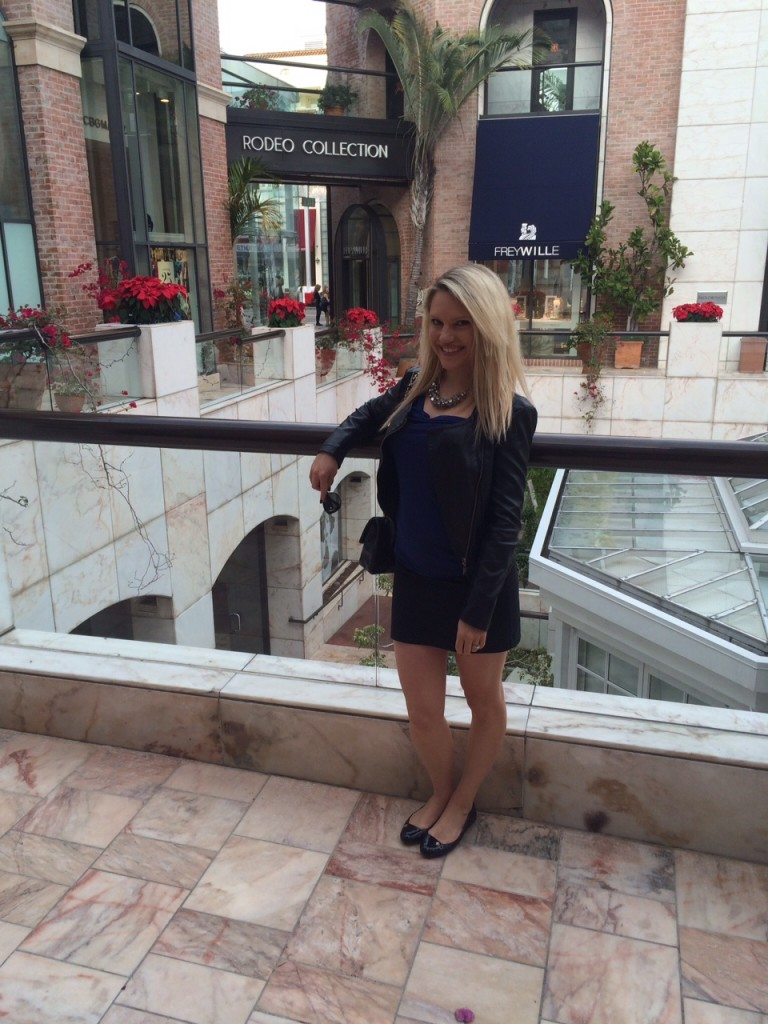 girl in leather jacket and black skirt on Rodeo Drive