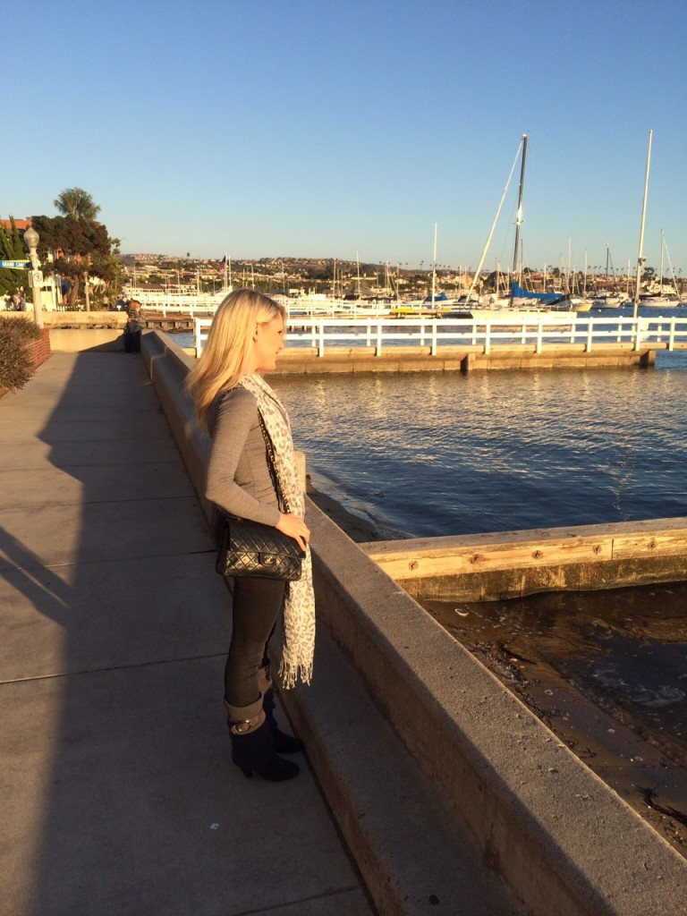 girl looking out at Newport Harbor, on Balboa Island Caitlin Hartley of Styled American