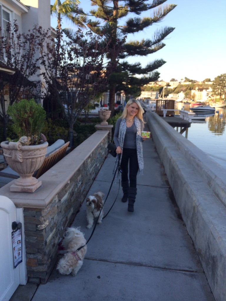 girl walkig her dogs on Balboa Island Caitlin Hartley of Styled American