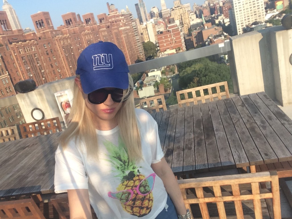 girl in NY giants hat and view of NY Caitlin Hartley of Styled American http://styledamerican.com/nycs-newest-resident/