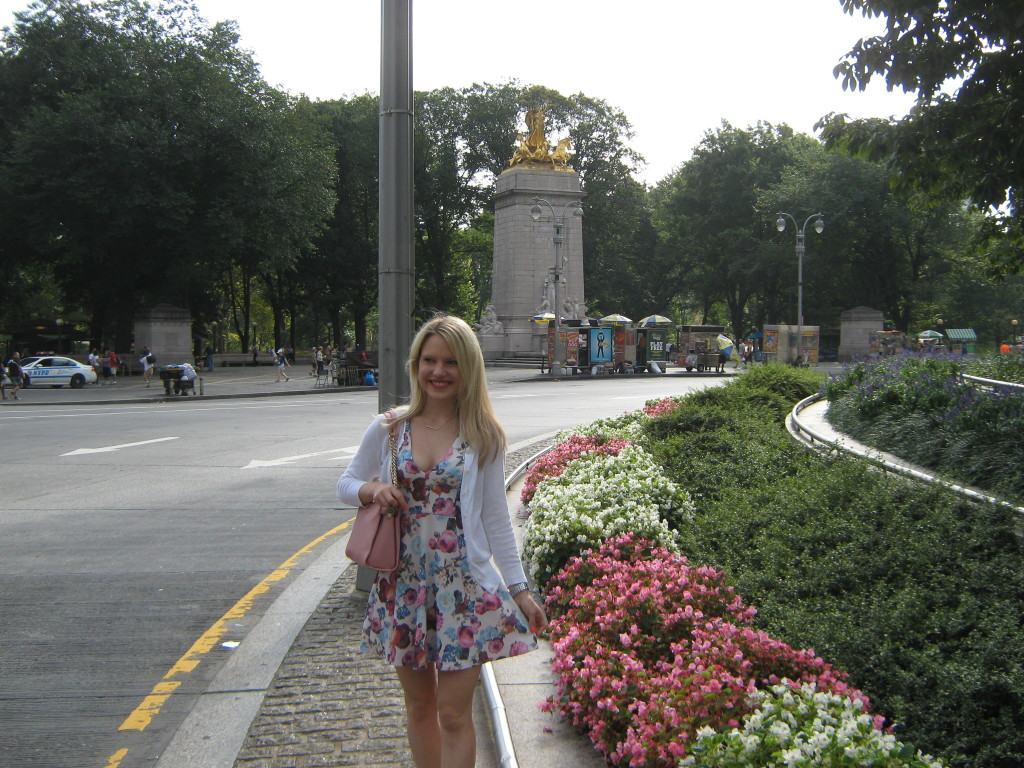 Caitlin Hartley of Styled American girl in floral dress in Columbus Circle