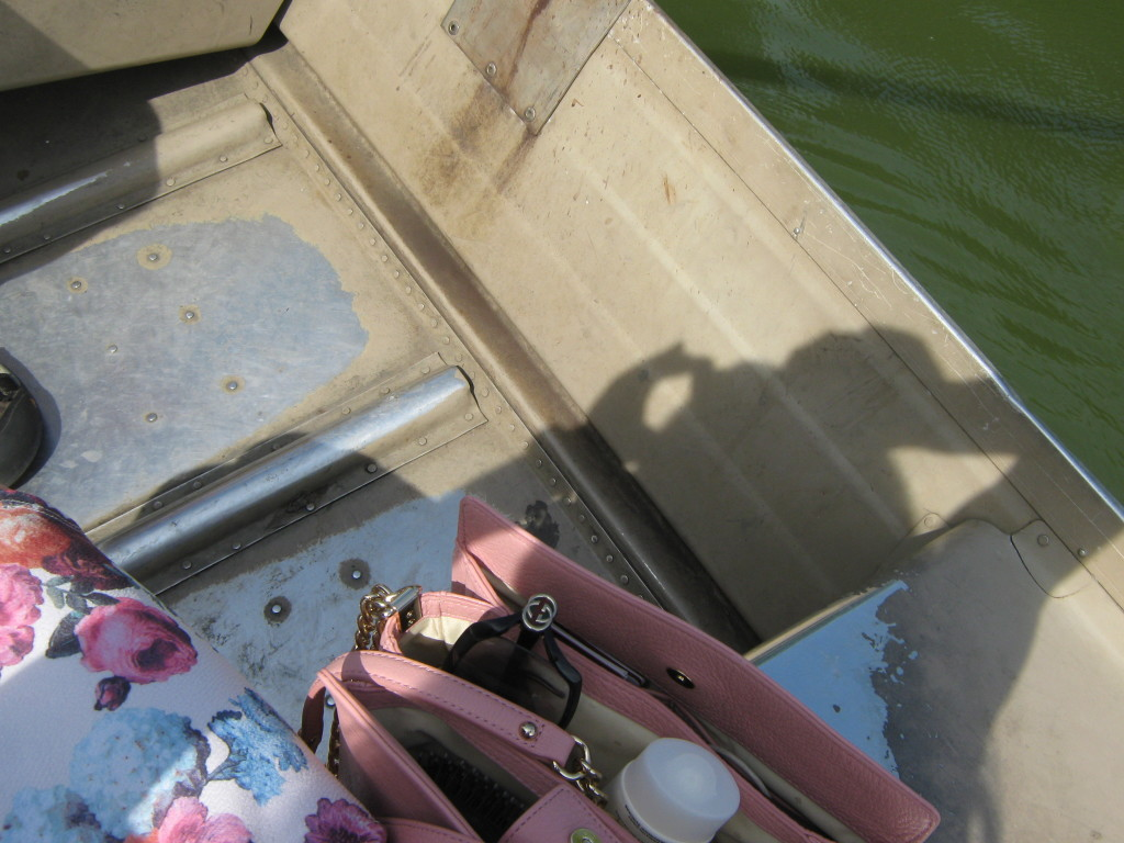 Caitlin Hartley of Styled American girls Kate Spade bag in a rowboat