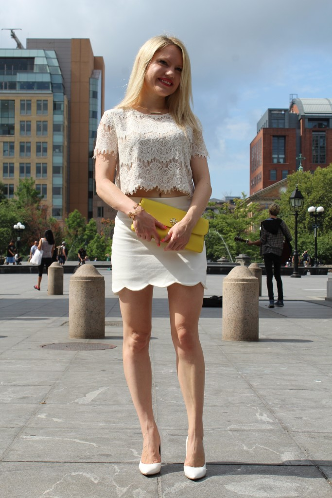 girl in white crop top and scalloped skirt holding clutch bag Caitlin Hartley of Styled American http://styledamerican.com/pop-of-yellow-2/