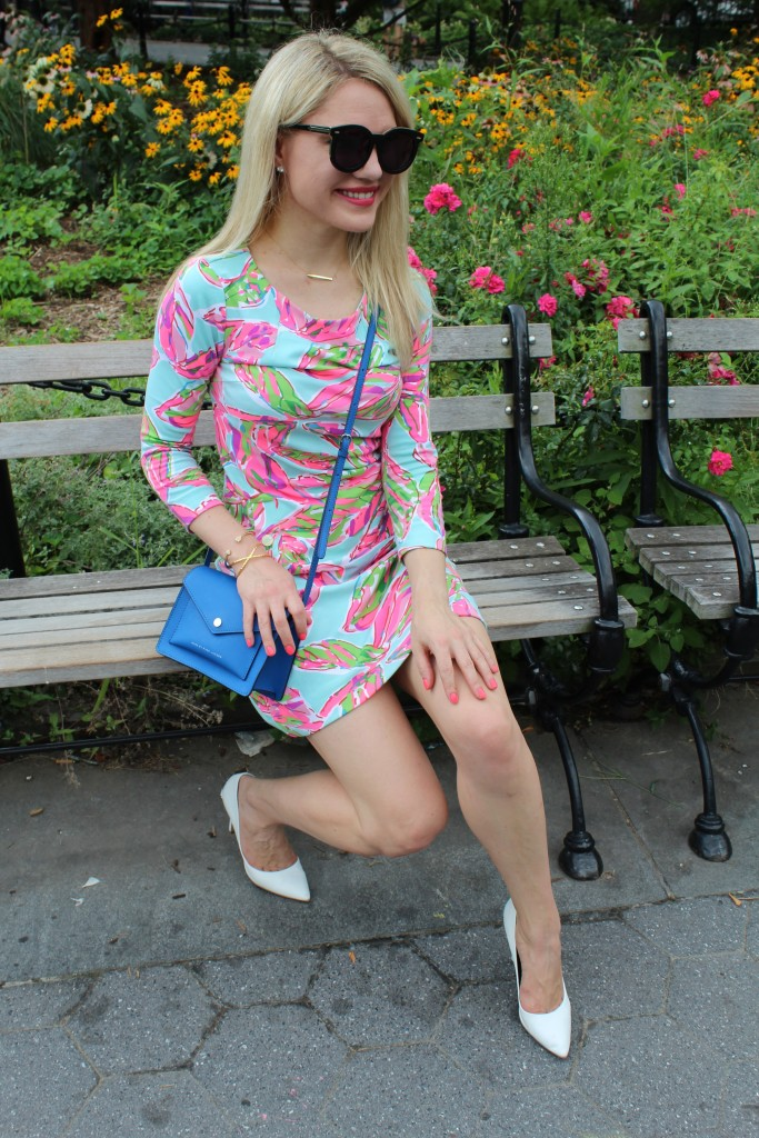 girl on a park bench in floral dress Caitlin Hartley of Styled American http://styledamerican.com/floral-work-dress/