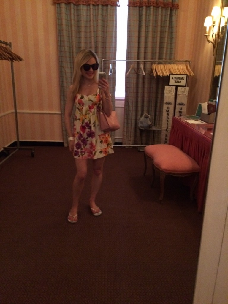 Caitlin Hartley of Styled American, girl in floral dress taking selfie at shopping event