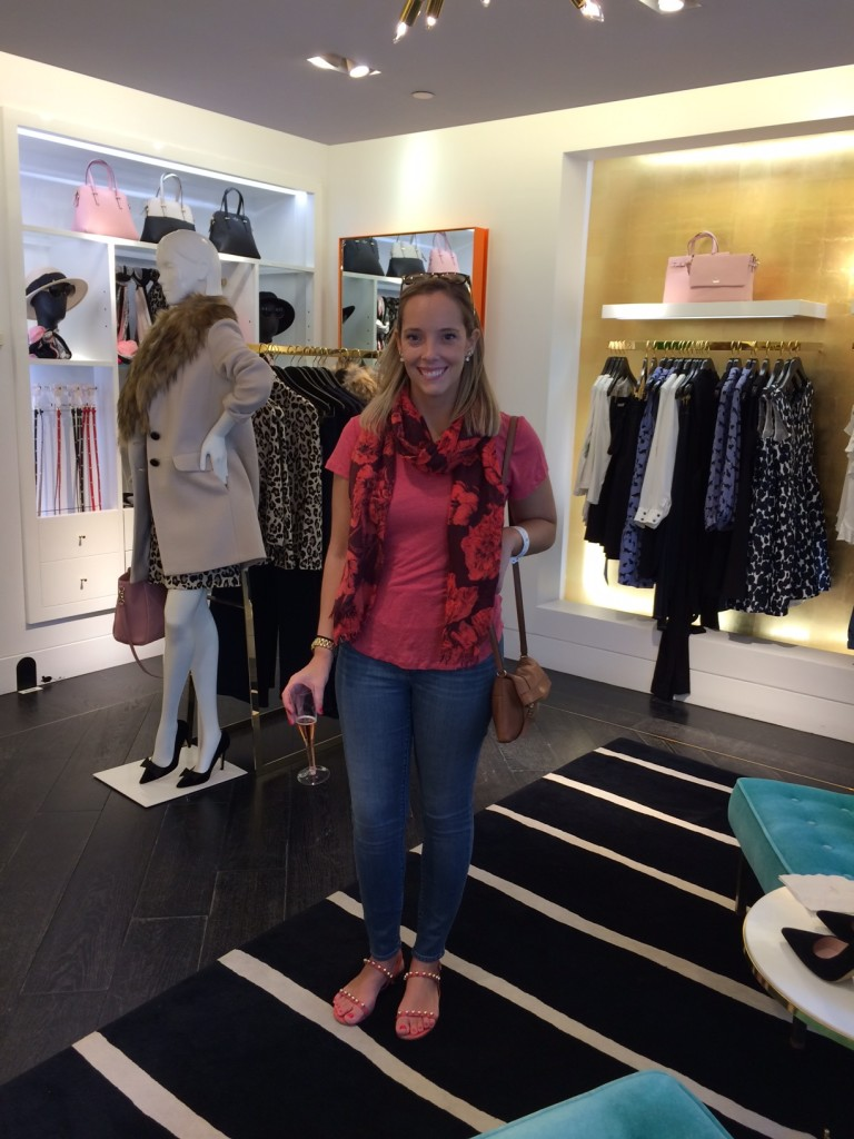Caitlin Hartley of Styled American girl in Kate Spade sipping champagne