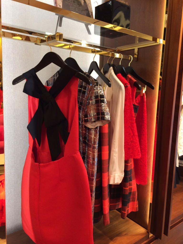 Caitlin Hartley of Styled American, hanging kate spade dresses with bows