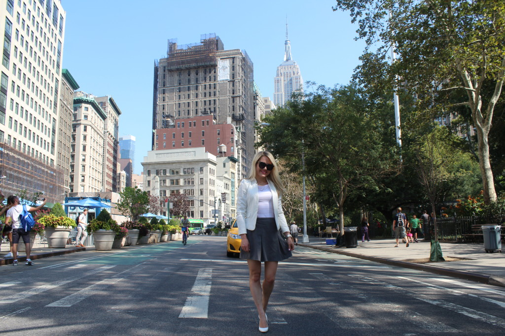 Caitlin Hartley of Styled American, work blazer, grey wool skirt, oversizd sunglasses