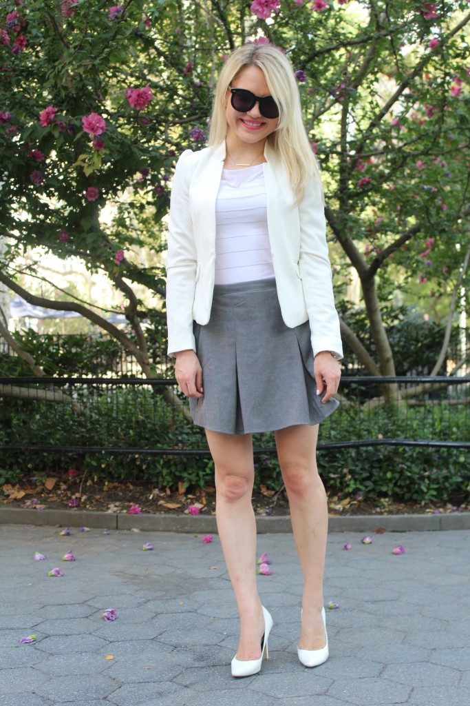 Caitlin Hartley of Styled American, white blazer, grey wool skirt and white pumps