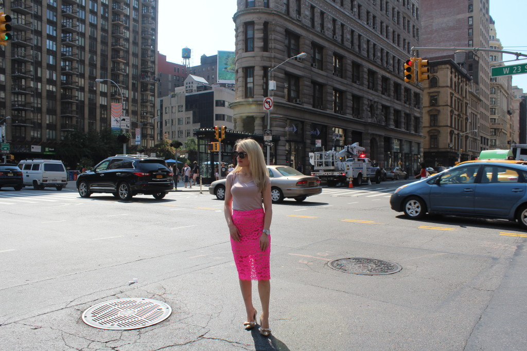 Caitlin Hartley of Styled American girl in hot pink lace skirt