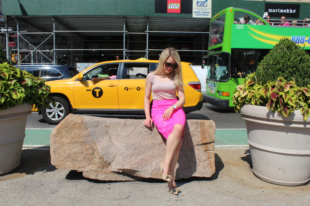 Caitlin Hartley of Styled American pink skirt and nude pumps