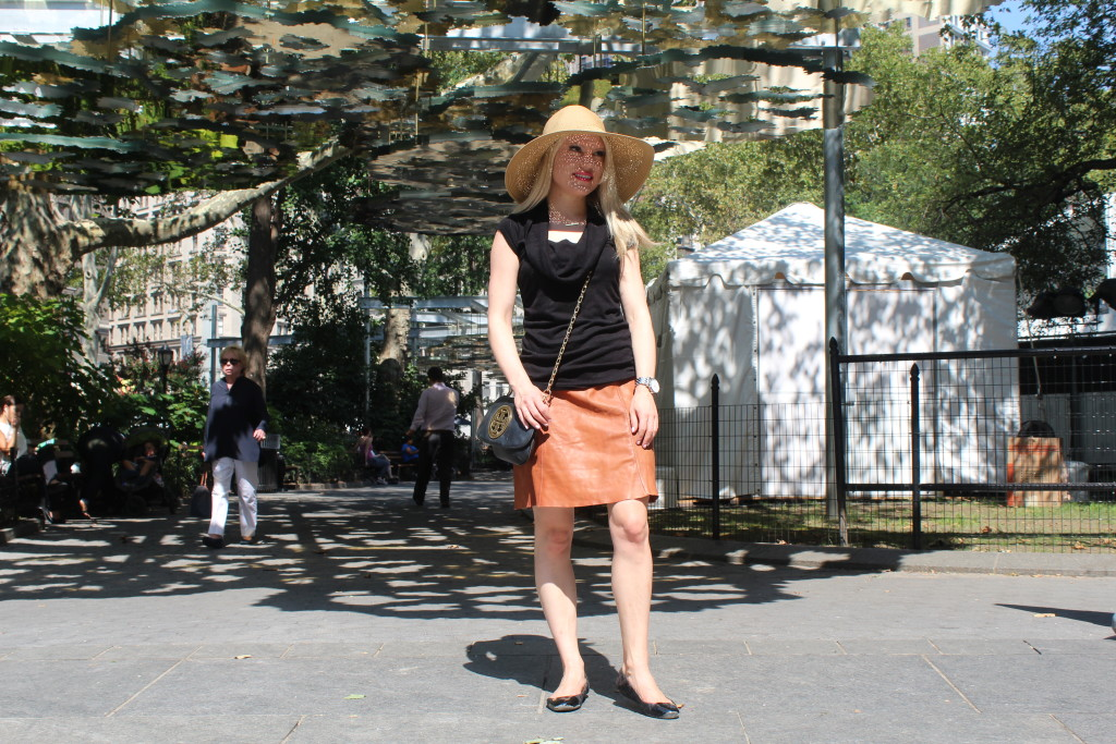 Caitlin Hartley of Styled American nyc street style, black cap sleeve top, nude leather skirt