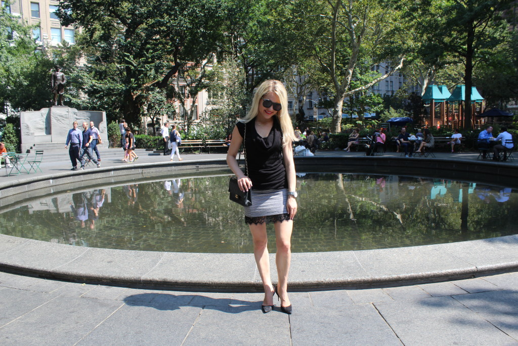 Caitlin Hartley of Styled American, black top, mini skirt and black chanel bag
