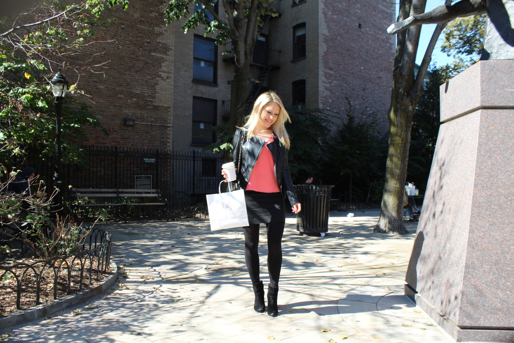 Caitlin Hartley of Styled American coral top, black jacket, tights and a mini skirt