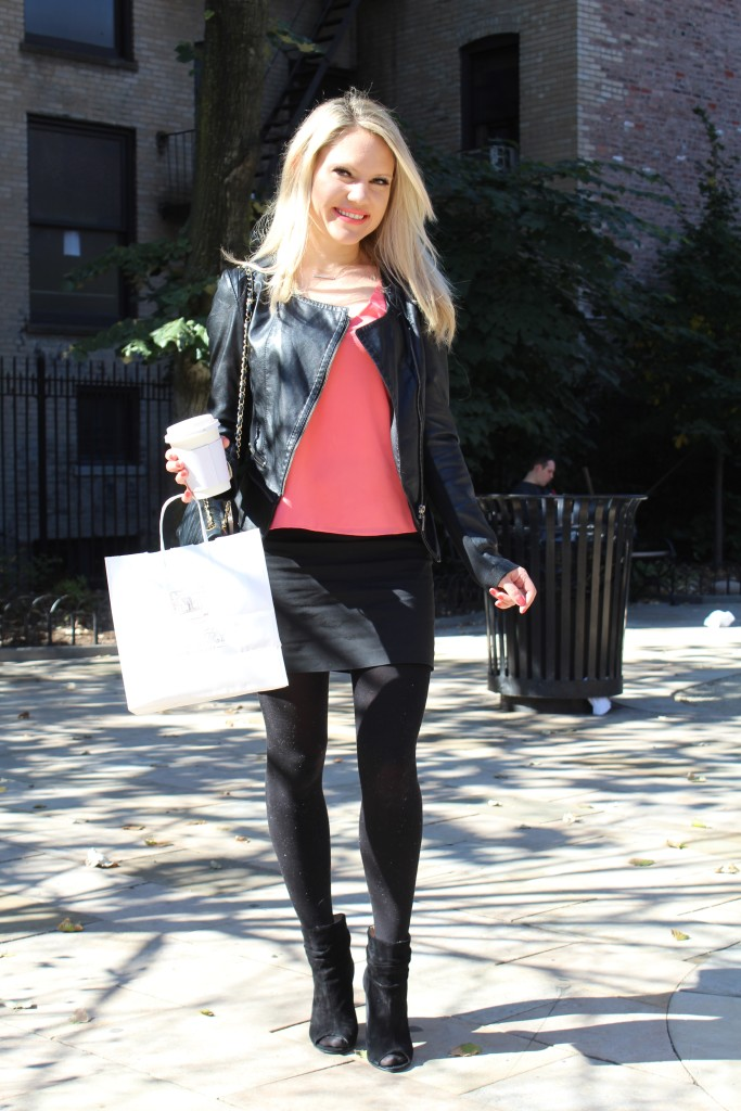 Caitlin Hartley of Styled American girl in leather jacket, mini skirt and tights