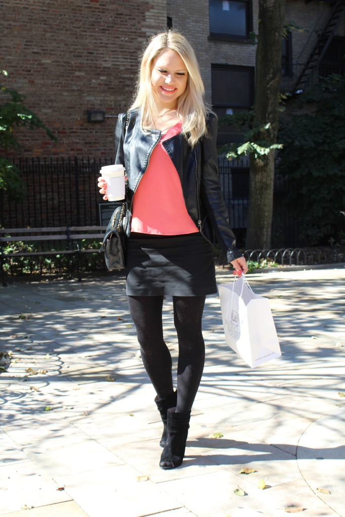 Caitlin Hartley of Styled American fitted leather jacket, black mini skirt, black tights and black booties