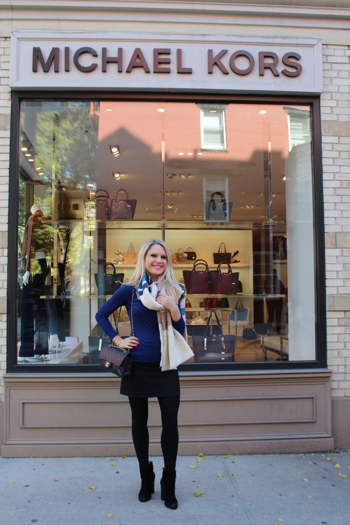 Caitlin Hartley of Styled American girl in front of michael kors