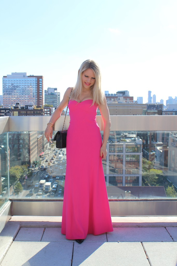 Caitlin Hartley of Styled American girl in hot pink dress with NYC in background