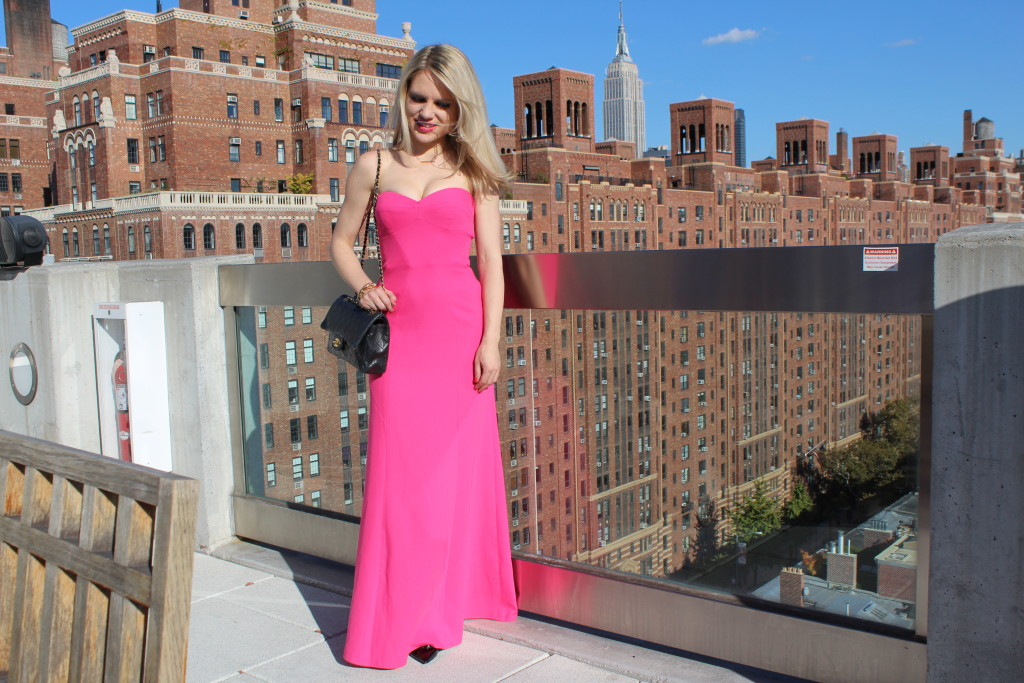 Caitlin Hartley of Styled American girl in pink gown with empire state building in the backdrop