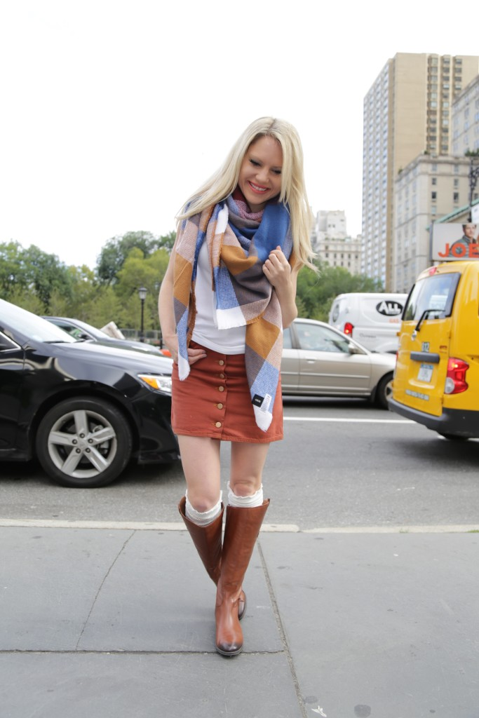 Caitlin Hartley of Styled American, ridding boots, mini skirt and blanket scarf