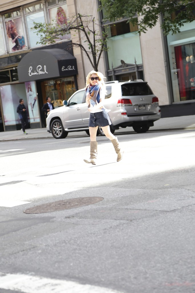 Caitlin Hartley of Styled American girl running across the street