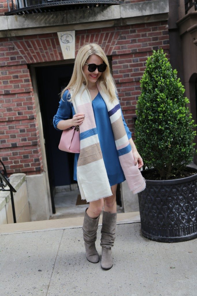 Caitlin Hartley of Styled oversized sunglasses, blue dress, grey flat boots