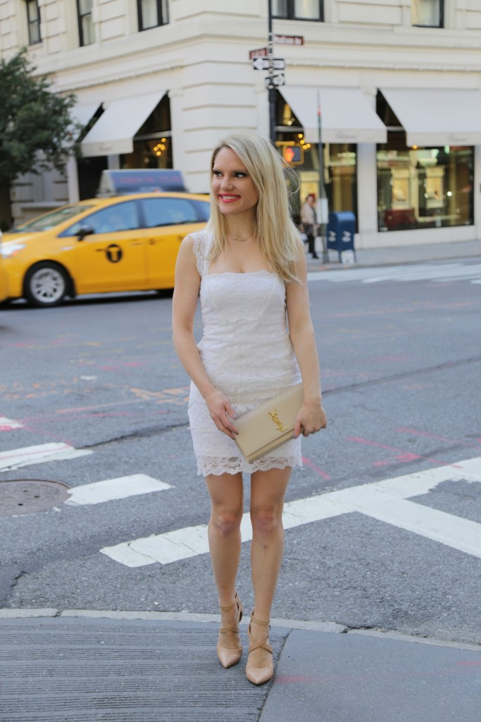 Caitlin Hartley of Styled American, white dress and nude clutch and nude pumps