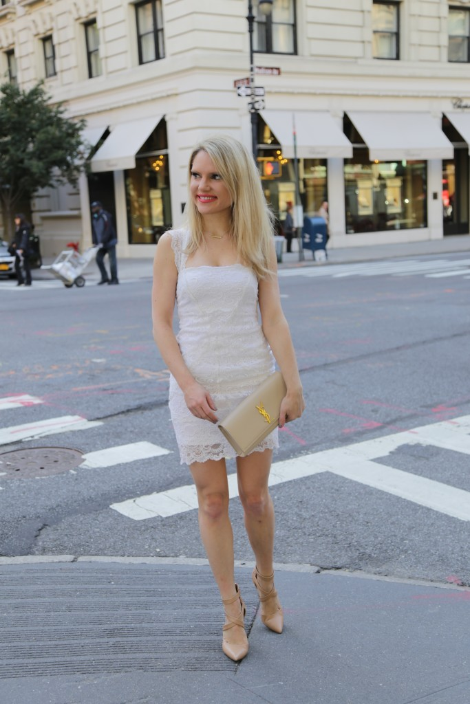 Caitlin Hartley of Styled American nude sandals, YSL clutch, lace dress