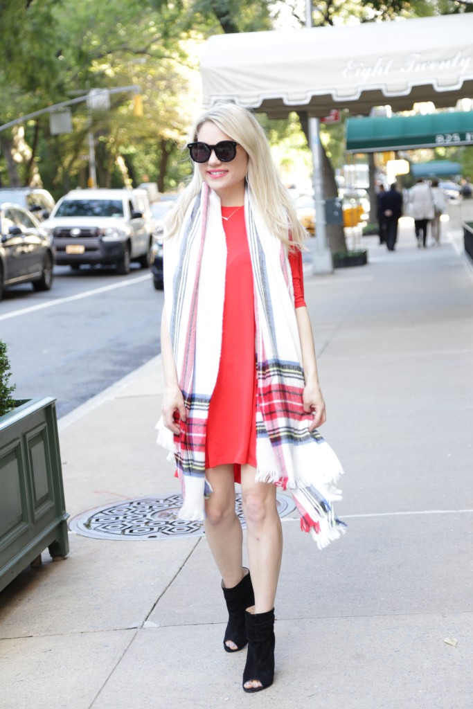 Caitlin Hartley of Styled American red shirt dress, black booties, oversized scarf