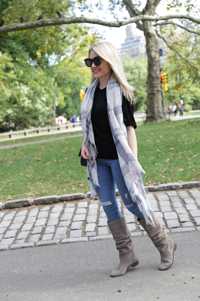 Caitlin Hartley of Styled American blue check scarf, ripped denim jeans, black top