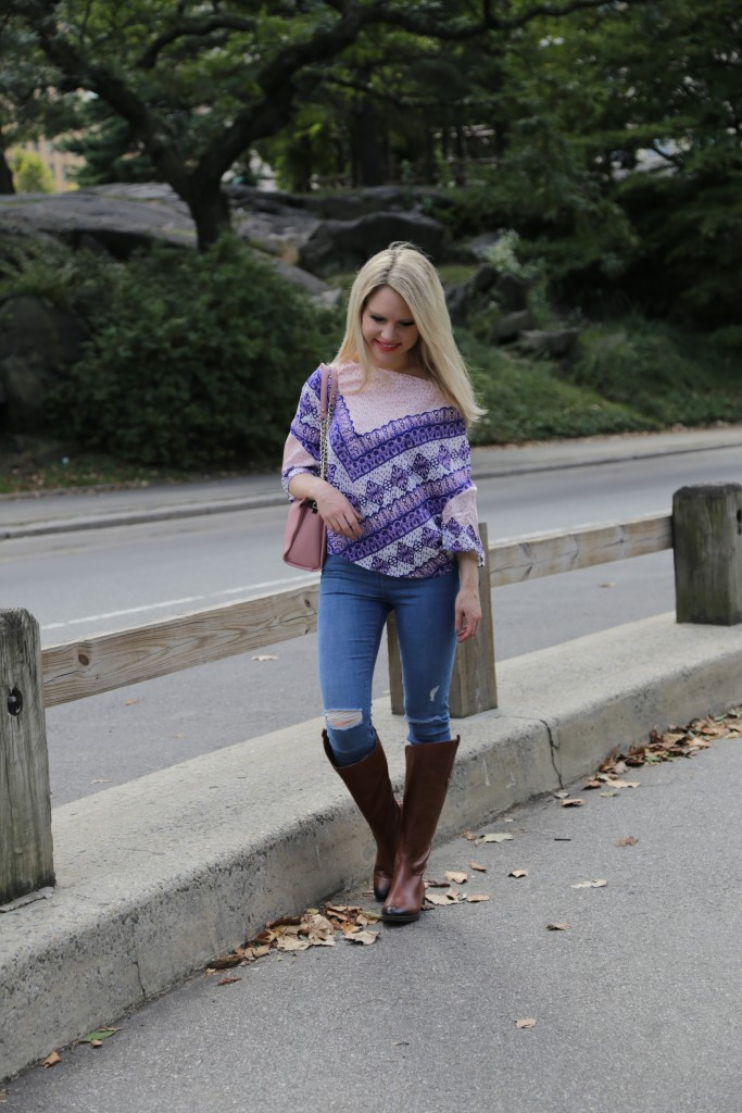 Caitlin Hartley of Styled American, ripped denim, poncho top