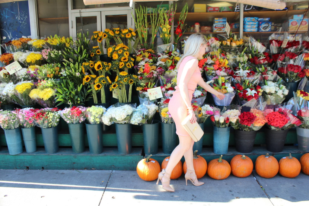 Caitlin Hartley of Styled American girl picking out flowers at a flower stand
