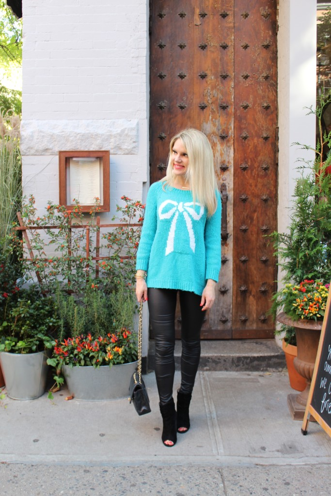 Caitlin Hartley of Styled American girl in bow sweater and leather pants