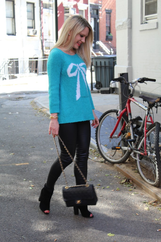 Caitlin Hartley of Styled American teal bow sweater