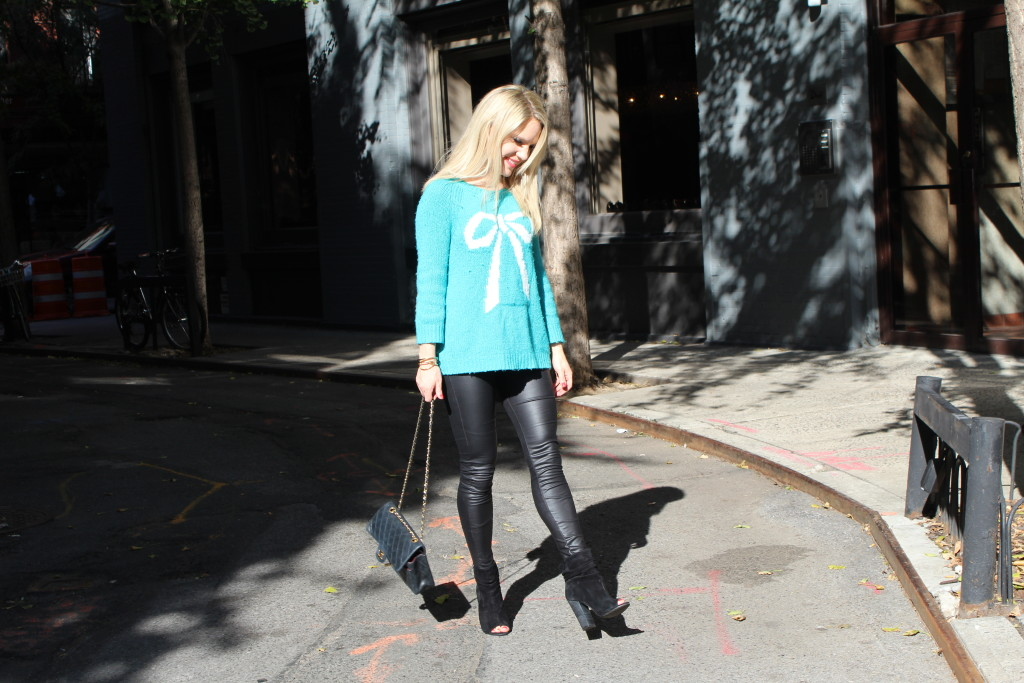Caitlin Hartley of Styled American bow sweater and liquid leggings