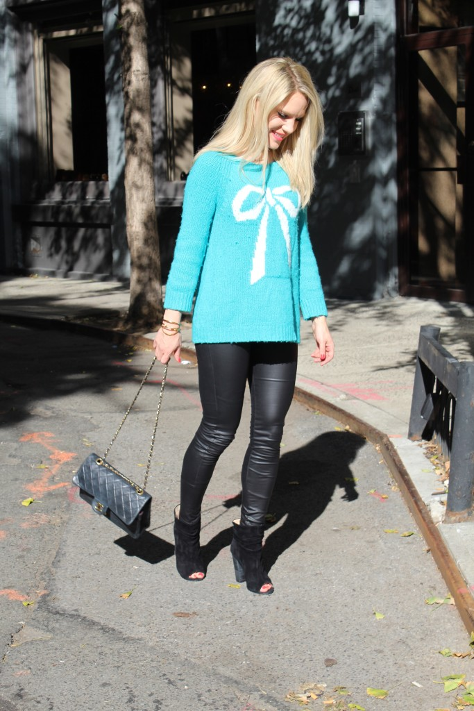 Caitlin Hartley of Styled American bow holiday sweater