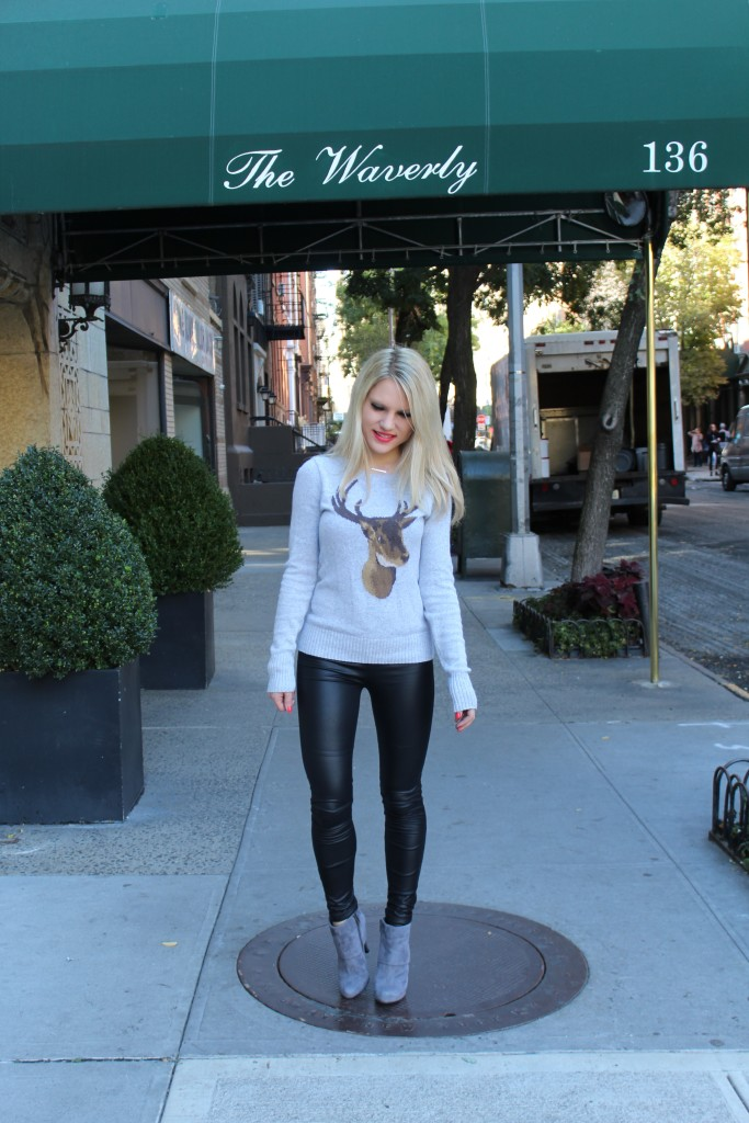 Caitlin Hartley of Styled American grey holiday sweater