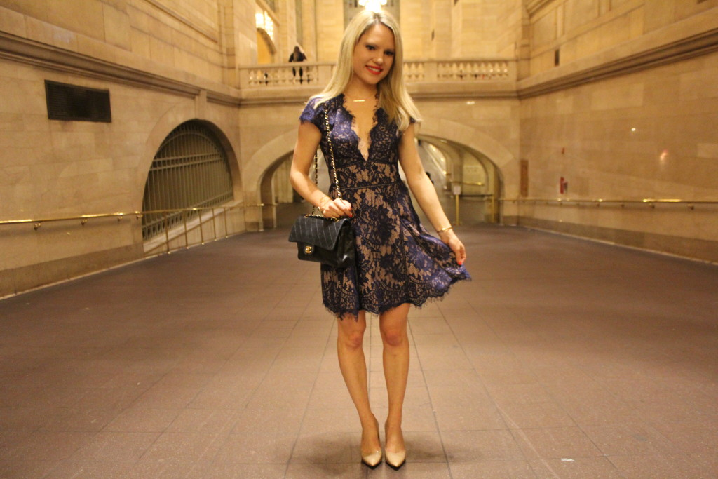 Caitlin Hartley of Styled American navy lace dress and chanel bag