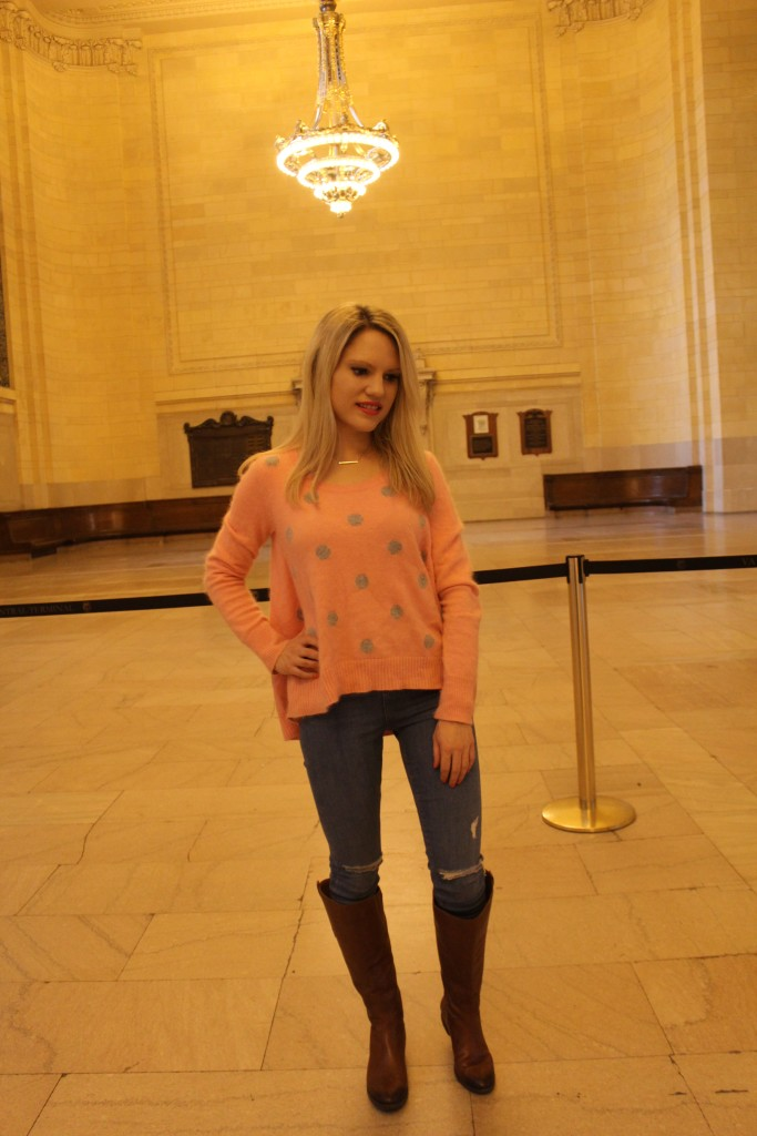Caitlin Hartley of Styled American polka dot sweater, ripped denim and riding boots