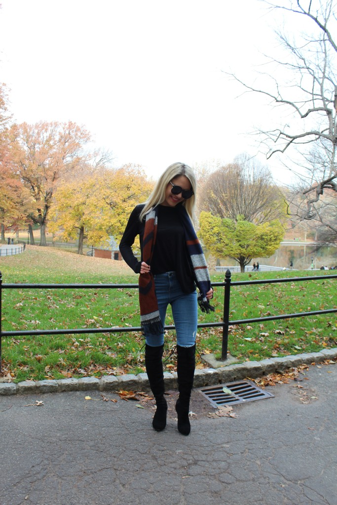 Caitlin Hartley of Styled American fashion blogger in central park, denim jeans and over the knee boots