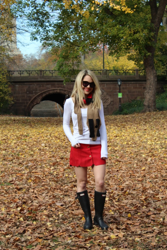 Caitlin Hartley of Styled American casual outfit with dog scarf, red mini skirt and black boots